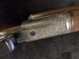 John Dickson , Edinburgh .16 bore round action ejector with damascus barrels . Made 1905 - 9 of 9