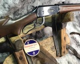 winchester model 64a , 30 30 ,98% ,unfired w/hang tag